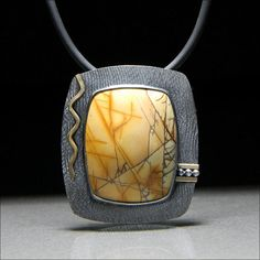 Jasper slide by William E Carlie ... Jasper in roll printed sterling with red brass elements, patina