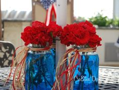 Mason jars with blue food coloring added to the water and fresh carnations. Great idea for any party :)  #holidays #party #summer