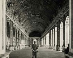 Photograph shows Pvt. Gordon Conrey of Milford, N.H., one of the first Americans to visit Versailles after its liberation, standing in the hall of mirrors.