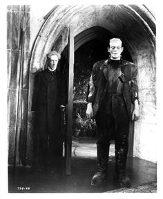 Boris Karloff as the Creature and Ernest Thesiger at Dr. Pretorius in The Bride of Frankenstein (1935)