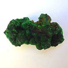 Malachite Mineral Specimen  Origin: DRC  Length: 8cm  Malachite is a perfect example of the mineral species with exceptional visual aesthetics, best viewed and turned in strong lighting. Malachite is widely believed to be named after the Greek word malache for mallow because of