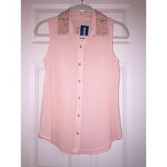 Pink Button-up Tank with Beaded Collar Size Small. Never worn. Tags are still attached. Sheer pink material with a small triangle of crocheted opening on back. Silver beaded collar. Comes with extra button. Tops Tank Tops