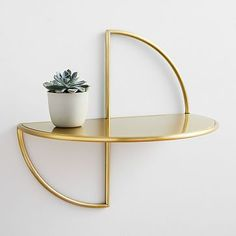 Half Moon Shelf BY West Elm. We're over the moon for this sculptural shelf, which instantly transforms books, vases or framed pictures into an eye-catching x x hardware included.Made in Indonesia. Mirror With Shelf, Mirror Wall Art, Frame Wall Decor, Home Wall Art, Frames On Wall, Display Shelves, Wall Shelves, Wall Desk, Room Planning