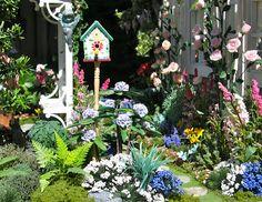 miniature dollhouse birdhouse and garden