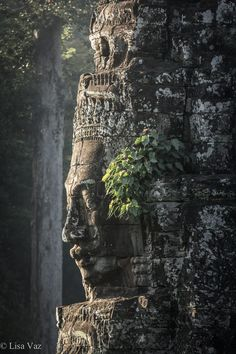 The 12th century Khmer Bayon Temple in Cambodia is known for its awsome smiling faces. It's part of the largest Hindu-Buddishm Sanctuary in the World, Angkor. Siem Reap, Cambodia