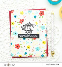 Everything about this card is just cute - the card layout, the color combination, and the cute flowers.  Create a floral stamped background by mixing the small images from different stamp sets. Know what Altenew supplies used on this project just by clicking this photo. www.altenew.com