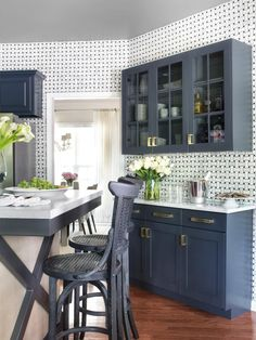A custom serving buffet was designed to provide extra storage, then finished with the same paint used on the existing kitchen cabinets for a cohesive look. See the before-and-after kitchen makeover at HGTVRemodels.com.
