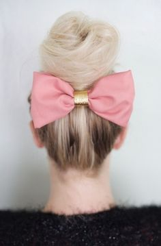 How cute is this bow under a gorgeous top knot bun?