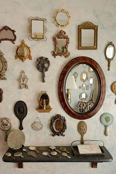 collection of vintage hand mirrors