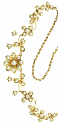 A beautiful gold and seed pearl flower necklace, Edwardian ear. From Carus Jewellery. Antique Gold, Antique Jewelry, Vintage Jewelry, Jewelry Stores, Jewelry Box, Jewellery, Pearl Design, Pearl Flower, Silver Brooch