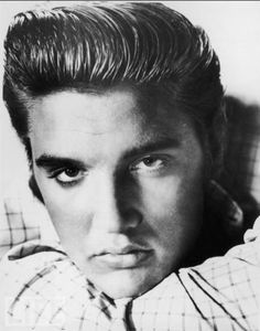 Elvis, 20, poses in 1955, the year Col. Tom Parker becomes his manager.
