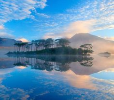 Misty morning reflection of the Twelve Bens in Derryclare Lough, Connemara, County Galway, Ireland