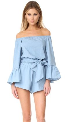 b6f7de8e956 del rio off shoulder romper by Lioness. An off shoulder neckline and  cropped bell sleeves lend a bohemian feel to this chambray Lioness romper.
