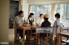 Stock Photo : Friends sharing a meal in cafe at the early aftern