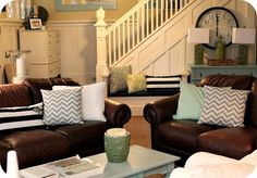 The Modern Cottage Company leather chair, leather sofa, white slipcovers, turquoise painted dresser, turquoise coffee table, white trim, pops of green and turquoise