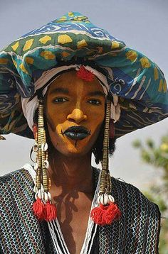 Obsessed with the Wodaabe men of the south Sahara. In a courtship ritual each year, they paint their face and done their finest to woo young women, who judge from afar. (Hintmag.com)