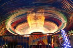 Long exposure carnival ride during blue hour