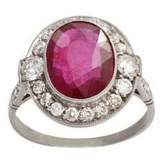 Platinum Art Deco Scissor Cut Ruby and Diamond Ring, 1920's