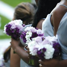 Bridesmaid bouquets of shades of purple and white
