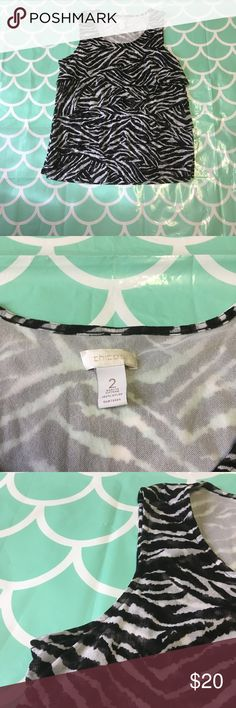 Chico's Zebra Print Tank Chico's. Zebra print. Size 2. Please refer to the size chart before purchasing to make sure it will fit you. Thank you! Chico's Tops Tank Tops