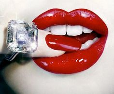 red lips go perfectly with BIG diamonds.....