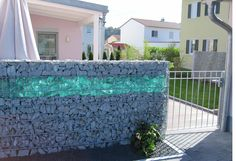 Glass gabion rock wall - Love the glass - wonder how expensive that stuff is