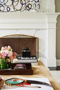 The Zhush: Our New Home: House Tour Part Two Love the herringbone pattern on the brick wall and marble surround of this fireplace.
