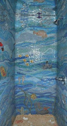 "Under the sea glass mosaic shower. Would be expensive, since the person doing it would have to be a real artist, but I love it! The ceiling appears to be mirrored, which increases the underwater effect. And the ""sand"" floor""- great!"