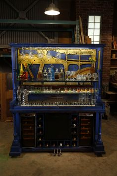 An old piano receives a new lease on life after being repurposed into a fun & funky piano bar!  Designed and built by Paul Lafrance Design.