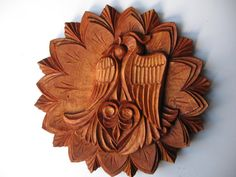 The offer is for a wood carving Two Love Birds which is 30cm in diameter. The item is made to order and I need 7 days to make it and prepare it for shipping. The item is hand made and especially suitable as a wedding or anniversary gift. It would have a metal rack on the back and it would be lacquered. I usually use some of the following materials: walnut, lime, pear, or cherry wood.