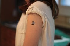 Small boat tattoo change your sails