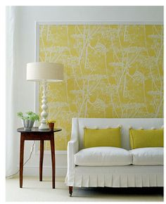 If you have a large blank wall that you don't know what to do with, consider framing up some wallpaper! Wallpaper comes in a wide variety and in all styles. And forget buying an expensive frame. Get some trim moulding cut to the proper size at Home Depot and paint it white. This makes for a dramatic (but inexpensive) piece of wall art.
