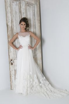 Eugenia style 3751 re-embroidered lace over sheer illusion neckline. Soft tulle in a sheath silhouette