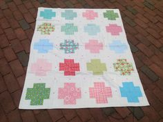 Patchwork cross/plus baby girl quilt by babyburritoquilts on Etsy, $125.00