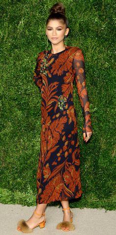 Zendaya in a rust leaf-motif bejeweled Thakoon midi-length dress.