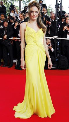 ANGELINA JOLIE IN EMANUEL UNGARO, Cannes 2007 Jolie hit the red carpet in a sweeping Ungaro canary yellow haute couture gown that cemented her status as one of Hollywood's hottest bombshells.