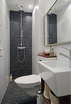Small bathroom ideas - Home and Garden Design Idea's - Wet Room bathroom with dark gray, blue and black thin tile tiled shower floor, floating porcelain vanity - modern and stylish