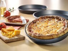 American Made Pizza Pans:    Use my personal invitation link to get a $10 credit.  Thank you!  http://osky.co/OyOFSu      Sale Price:  $36 - $59