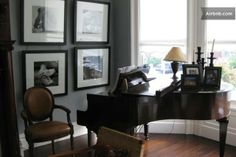 Living room with antique grand piano.