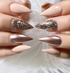 Nude and glittery stilletto nails.