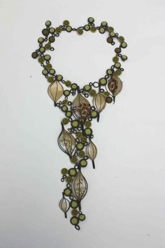 Inspired by the clothes found in a child's dressing up box and traditional costume jewellery. All made from textile and silver wire by Betty Pepper