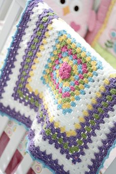 Crocheted baby blanket by little rays of sunshine.  The pattern used is Lion Brand Yarn - Pattern # L10273:  Lion Brand Jamie Marble Baby Throw (center flower not part of this pattern).