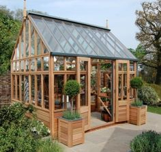 The RHS Planthouse - Gabriel Ash website - designs for many greenhouses, potting sheds, etc.