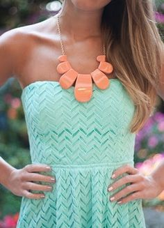 mint sweetheart neckline dress with coral statement necklace