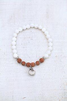 Rudraksha bracelet with charm shell charm metal beads
