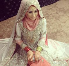 Hijab bride in cream white and coral pink. More
