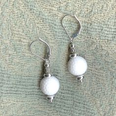 Wear these golf ball earrings while you putt around by gwynstone. Explore more products on http://gwynstone.etsy.com