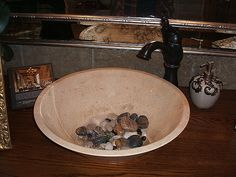 Rocks in bathroom sink, My sister-in-law does this and I really like how it looks.