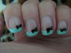 cute teal and black bow nail design