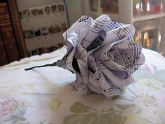Paper Rose Boutonniere   Steps how to:  http://www.cutoutandkeep.net/projects/paper-rose-boutonniere#